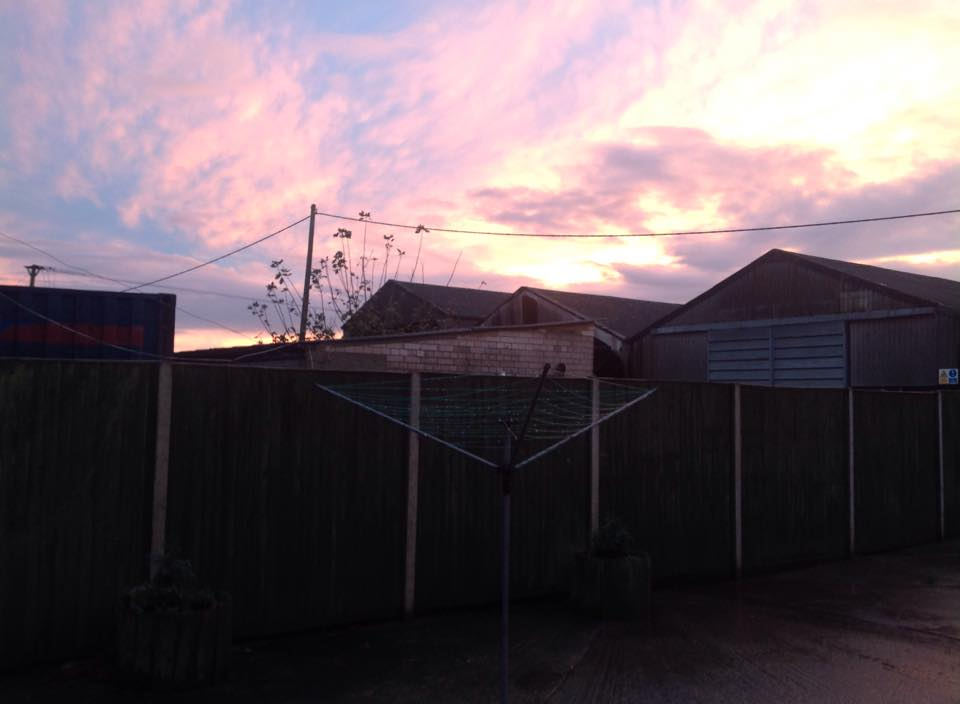 View of last night's sunset from my bedroom window. Please excuse our washing line!
